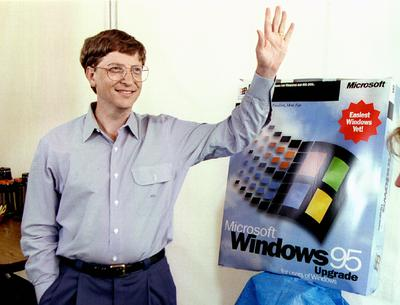 Microsoft CEO Bill Gates stands beside a model  of the new Windows '95 product as he waves to a friend at the Microsoft campus in Redmond, August 23 during rehearsals for the August 24 launch of Windows '95.   The current Microsoft  Windows provides the operating system for about 80 percent of the personal computers sold today,Image: 448212268, License: Rights-managed, Restrictions: , Model Release: no, Credit line: Jeff Vinnick / Reuters / Forum
